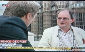 Being interviewed about Prince George's names below the statue of George V opposite the Palace of Westminster for Sky news on the evening of 24 July
