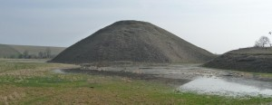 Silbury Hill, Wiltshire, a massive, Neolithic monument which might, as this book suggests, embody an ancient British origin myth of the world being formed by an earth mound out of the primal seas.